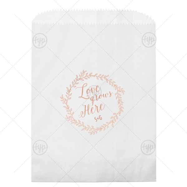 Love Grows Here Wedding Bag | Our personalized White Party Bag with Shiny Rose Gold Foil has a Rustic Wreath graphic and is good for use in Frames, Wedding, Anniversary themed parties and will make your guests swoon. Personalize your party's theme today.