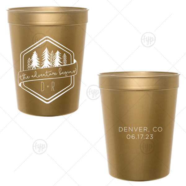 Adventure Begins Trees Cup | Dress up drinks with your theme! Pair your initials with the banner and trees in our Adventure Badge for a seamless detail in your forest or greenery themed wedding. Add your destination and date to the back for a personal touch. Fun in the moment, they will also make fetching personalized wedding favors.
